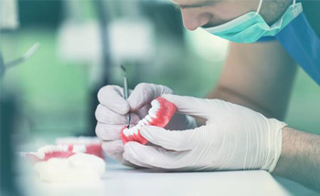 Lab technician creating dentures