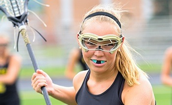 Girl wearing athletic mouthguard