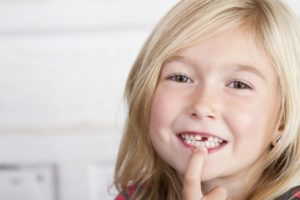 girl pointing to teeth