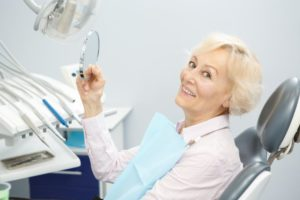 Woman excited to replace her dentures